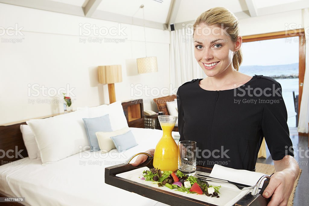Portrait Of Hotel Worker Delivering Room Service Meal royalty-free stock photo