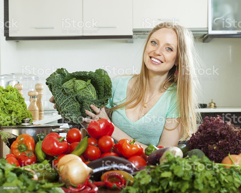 Portrait of  housewife with  cabbage and  vegetables royalty-free stock photo