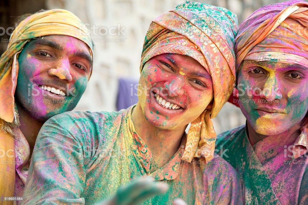 Portrait of Indian men playing holi stock photo