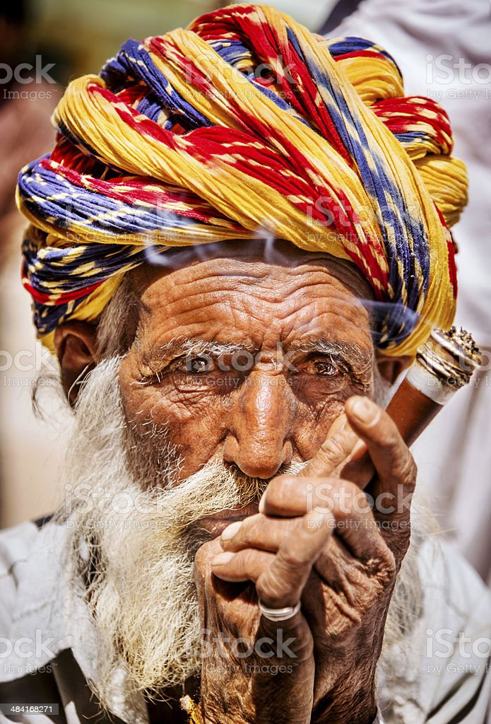 Portrait of Indian old man smoking stock photo