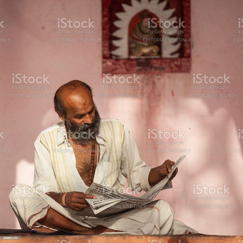 Portrait Of Indian Senior Man Reading Newspaper stock photo