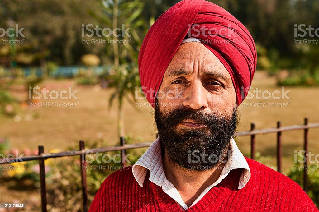 Portrait of Indian Sikh man near temple in Delhi stock photo