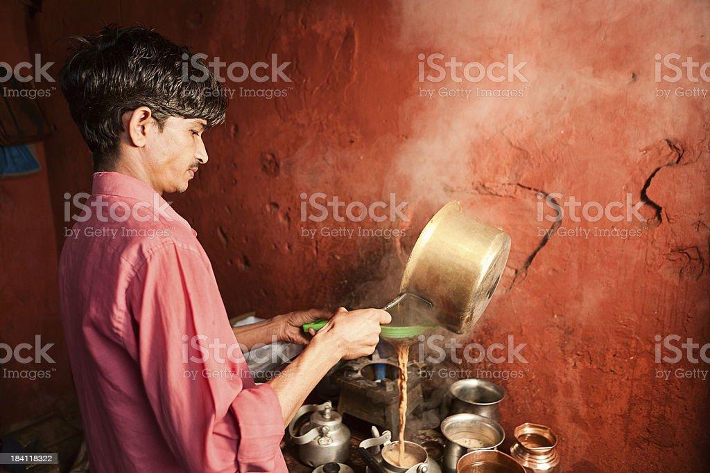 Portrait of Indian street seller selling tea - masala chai royalty-free stock photo