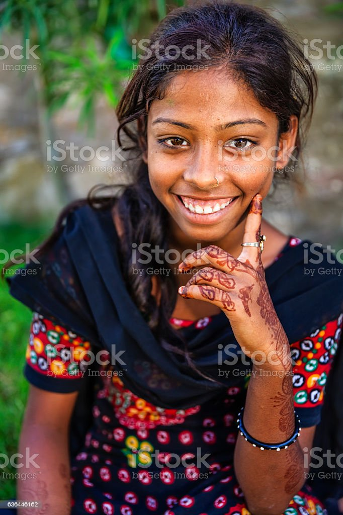 Portrait of Indian young girl with henna tattoo, Jaipur, India stock photo