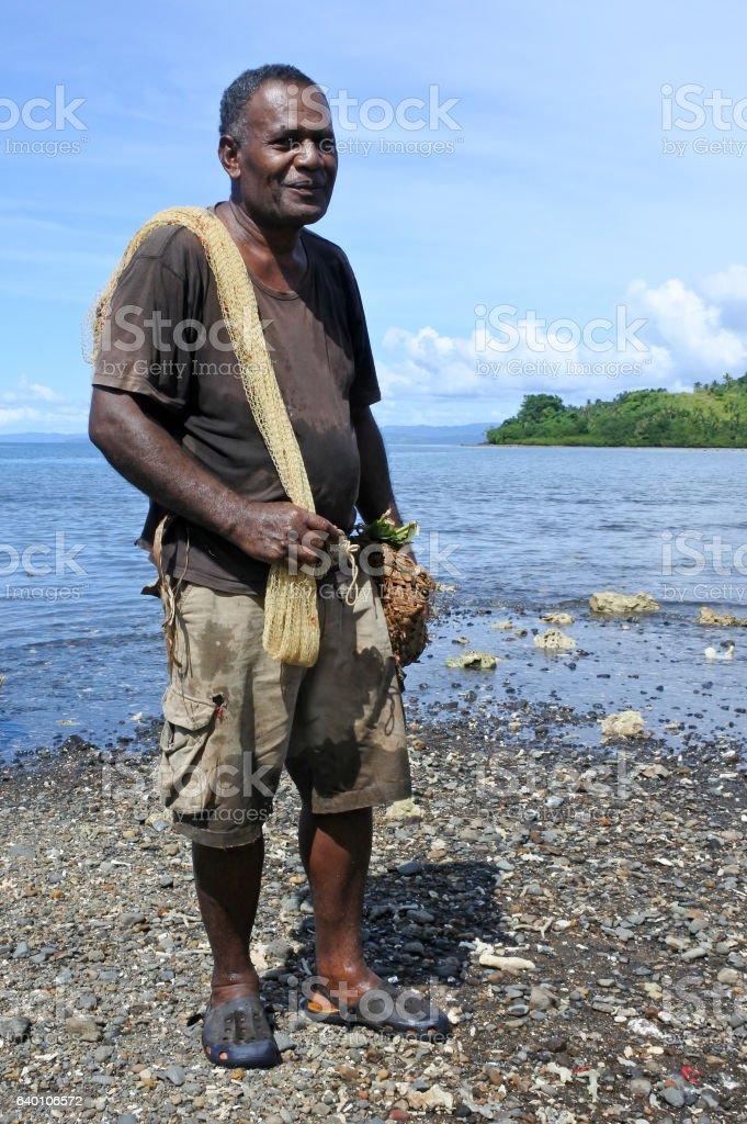 Portrait of Indigenous Fijian fisherman going fishing in Fiji stock photo