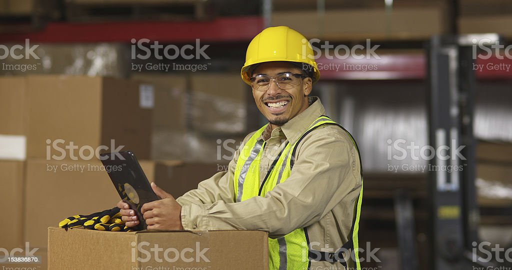 Portrait of industry worker in warehouse with digital tablet royalty-free stock photo