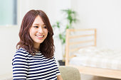 Portrait of Japanese woman in a living room