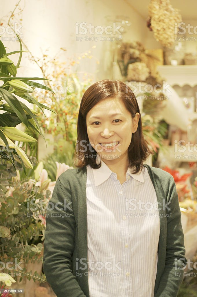 Portrait of Japanese woman in flower shop. stock photo