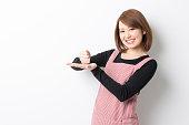 Portrait of Japanese woman wearing apron
