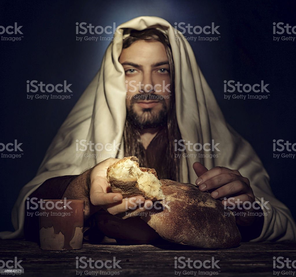 Portrait of Jesus holding bread in The Last Supper stock photo