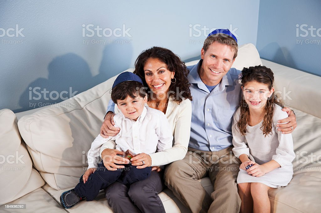 Portrait of Jewish family sitting on sofa stock photo