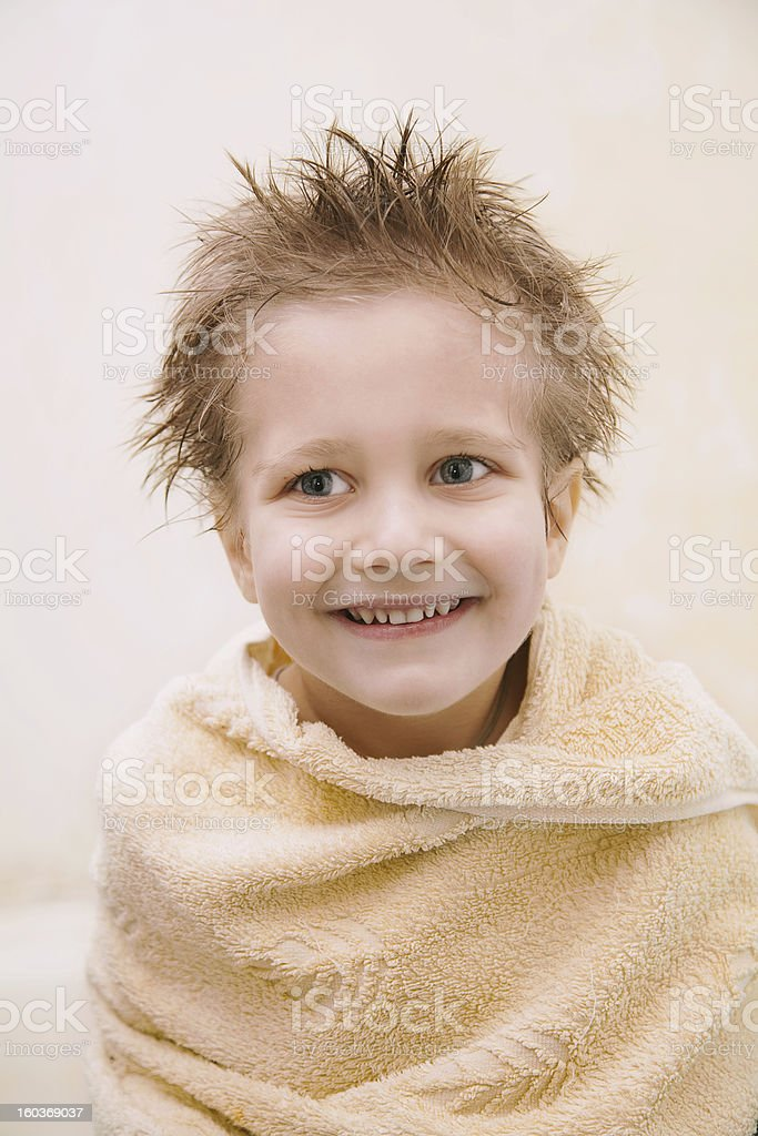 portrait of joyful boy with wet hair stock photo