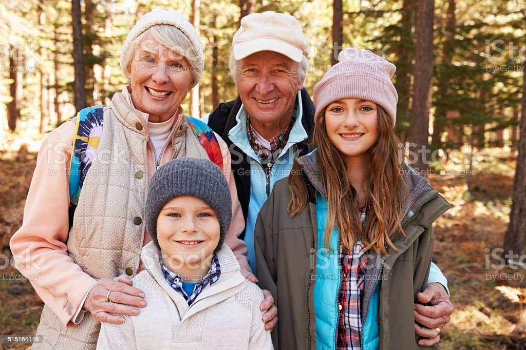 Portrait of kids and grandparents in forest stock photo