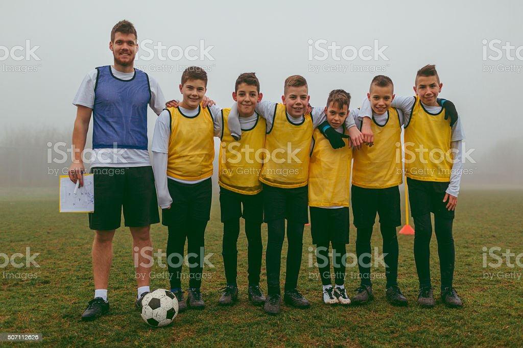 Portrait of Kids Team With Coach After Playing soccer stock photo