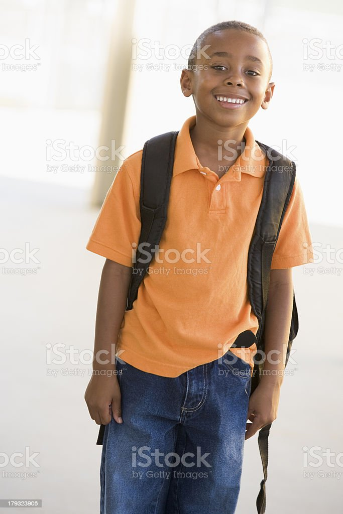 Portrait of kindergarten boy with backpack stock photo