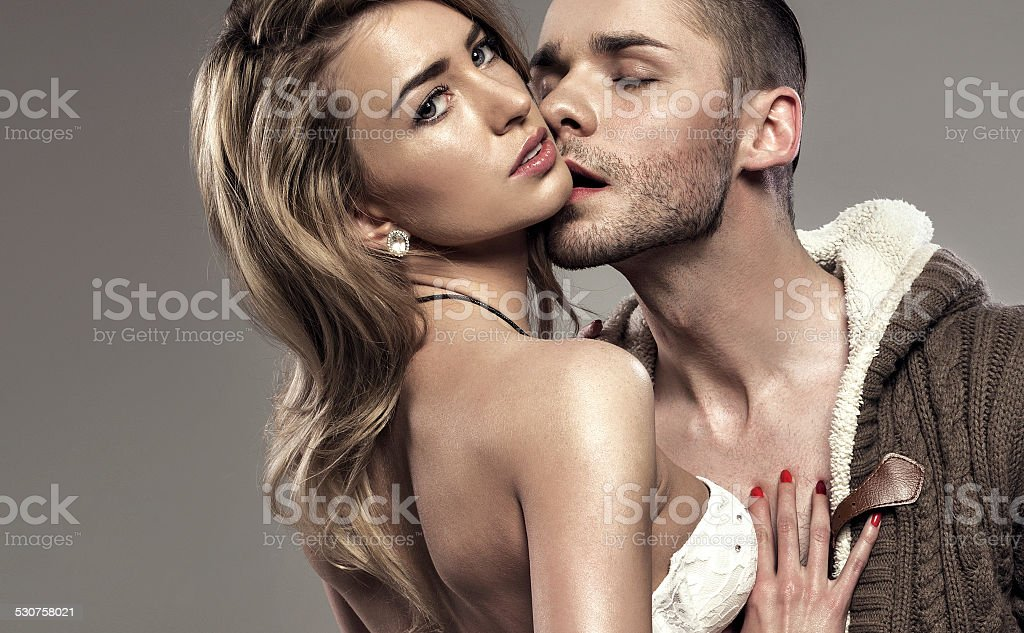 Portrait of kissing couple stock photo
