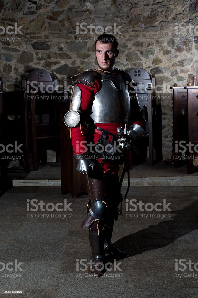 Portrait of Knight in Armor Standing in Old Monastery stock photo