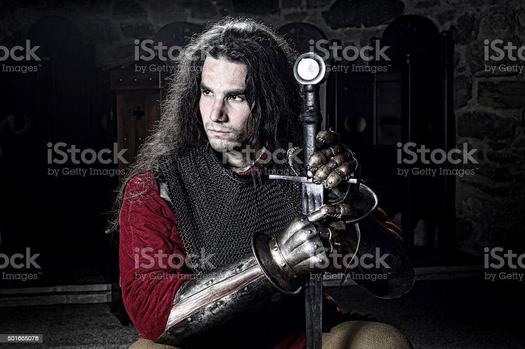 Portrait of Knight in Chain Mail , Metal Gloves and Sword stock photo