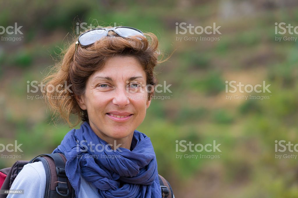Portrait of lady with natural expression, outdoors stock photo