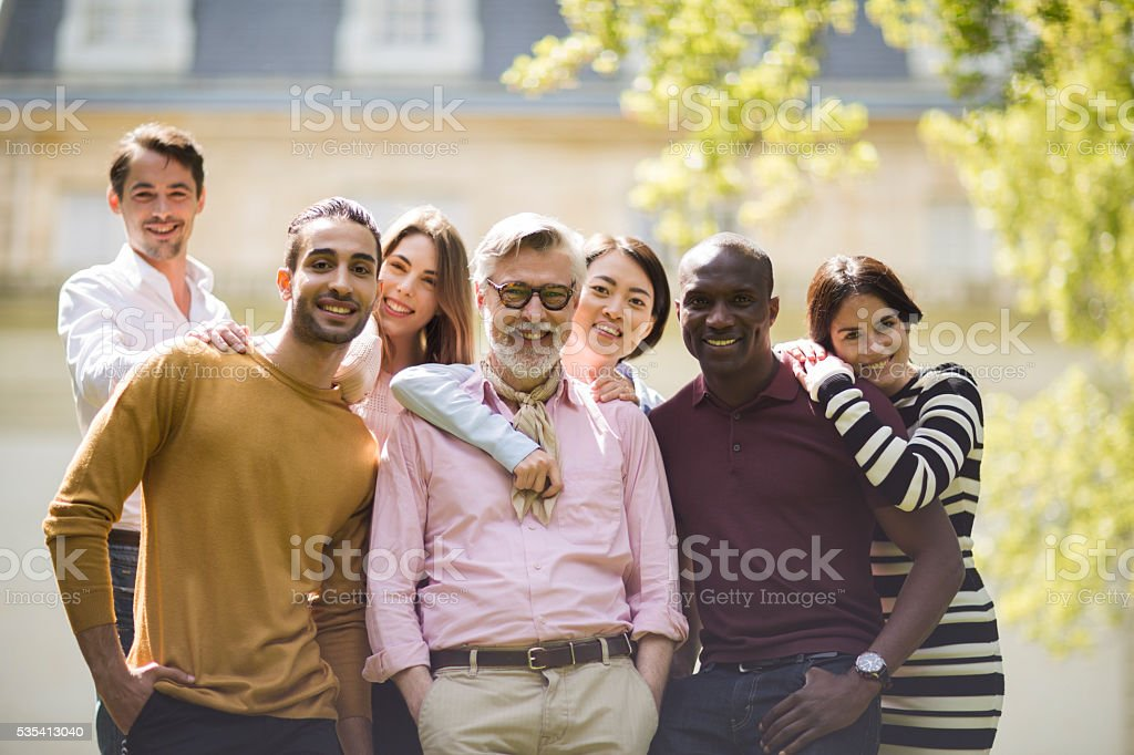 Portrait of large group looking at camera. stock photo