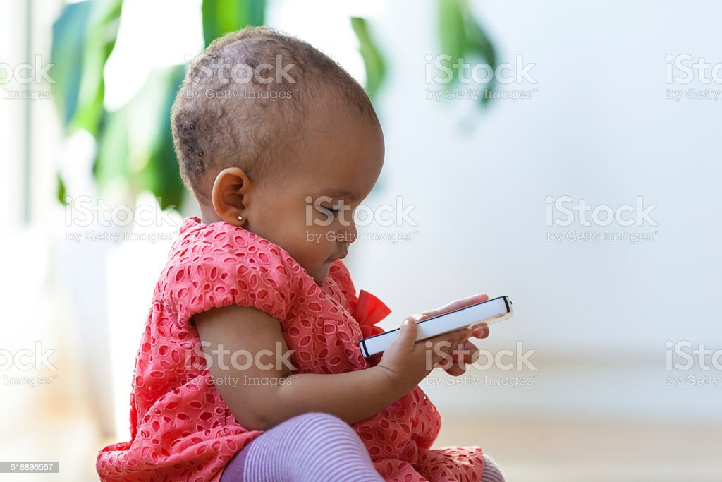 Portrait of little African American little girl holding a mobile stock photo