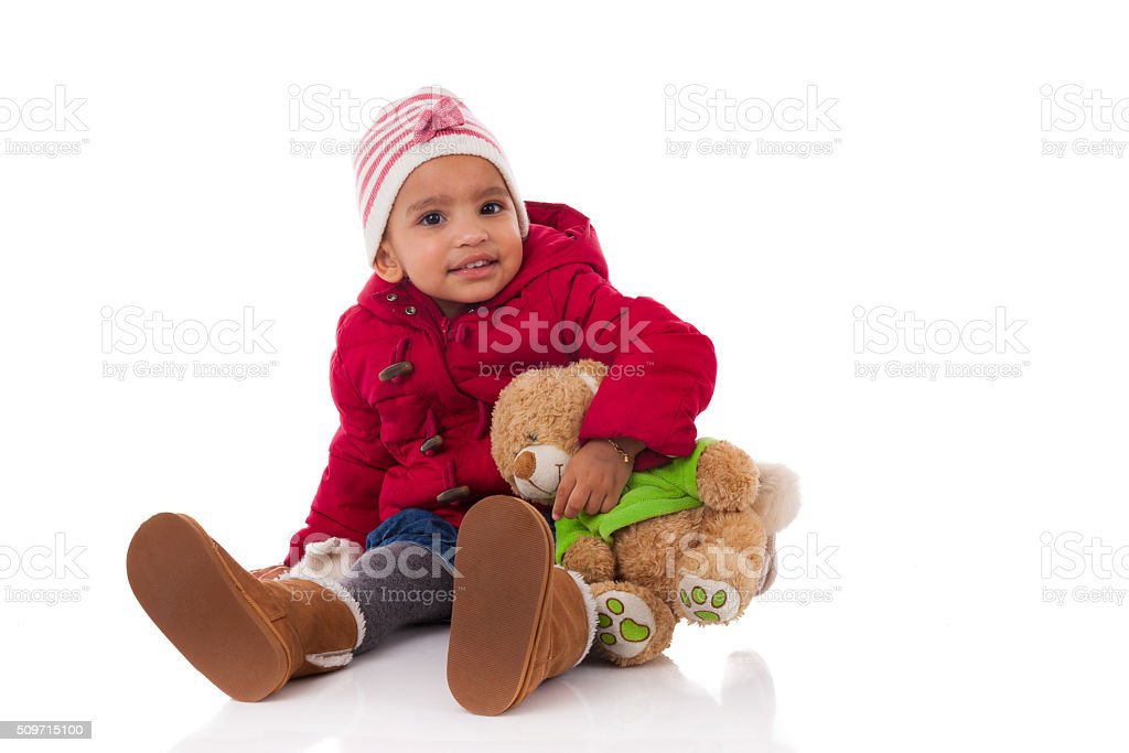 Portrait of little African American little girl holding a teddy stock photo