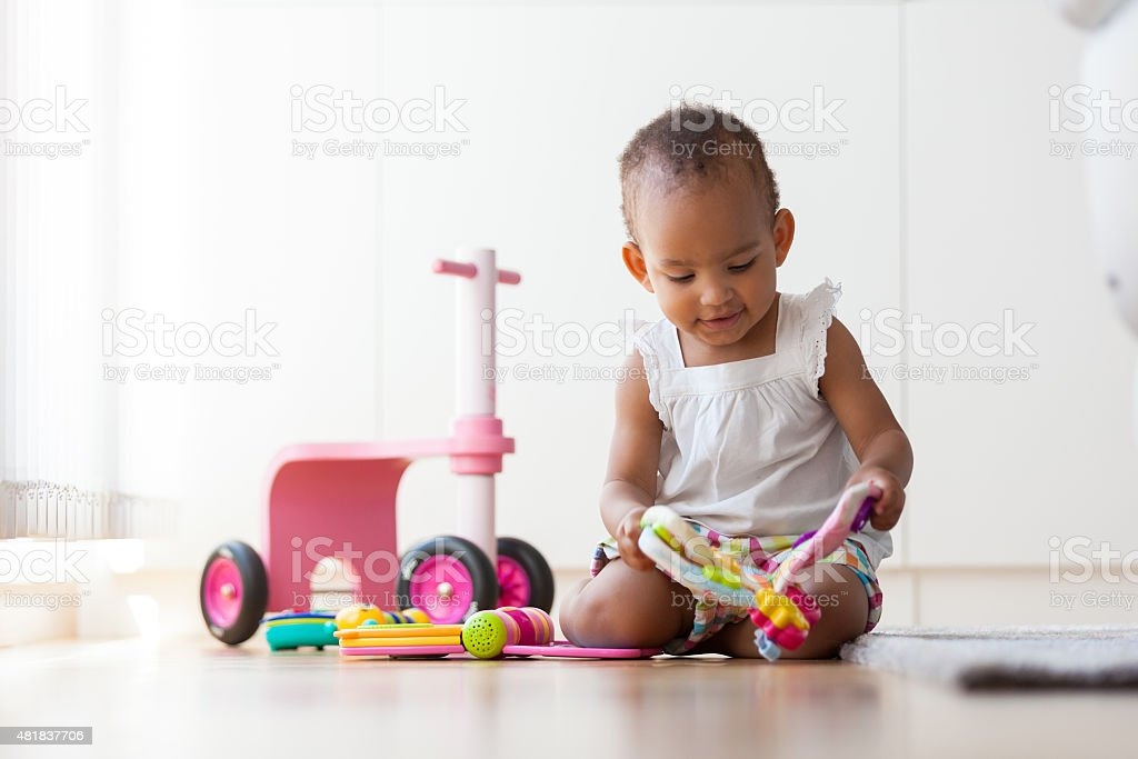Portrait of little African American little girl playing stock photo