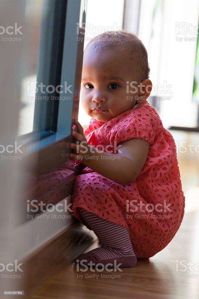 Portrait of little African American little girl sitting stock photo