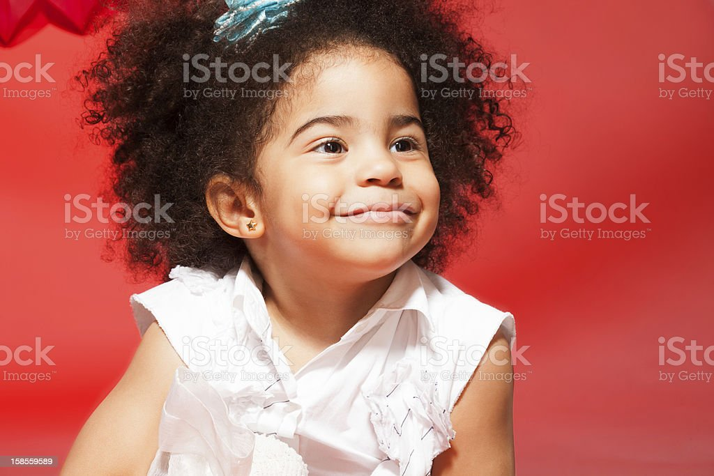 Portrait of little black curly haired girl royalty-free stock photo