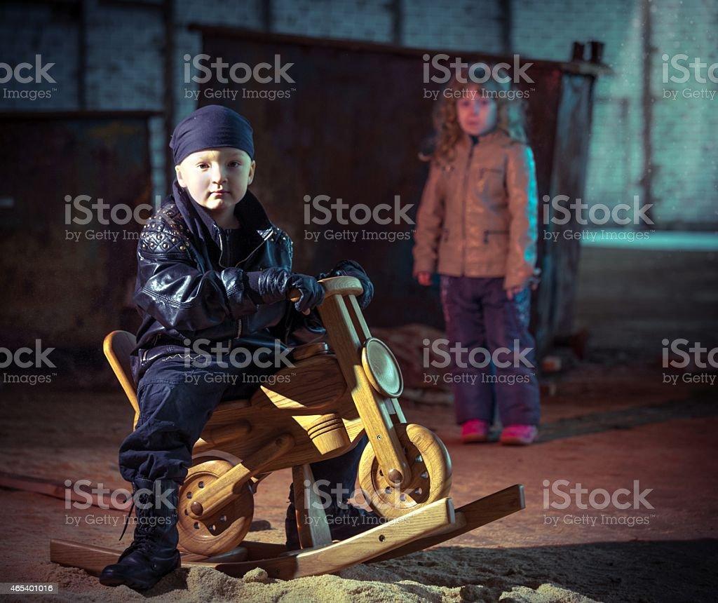 Portrait of little boy biker stock photo