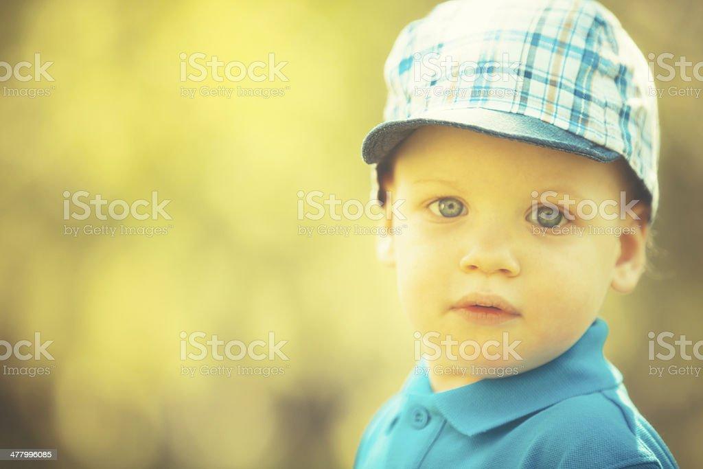 Portrait of little boy in park royalty-free stock photo