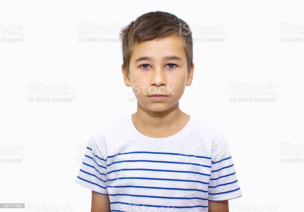 Portrait of little boy over white background stock photo
