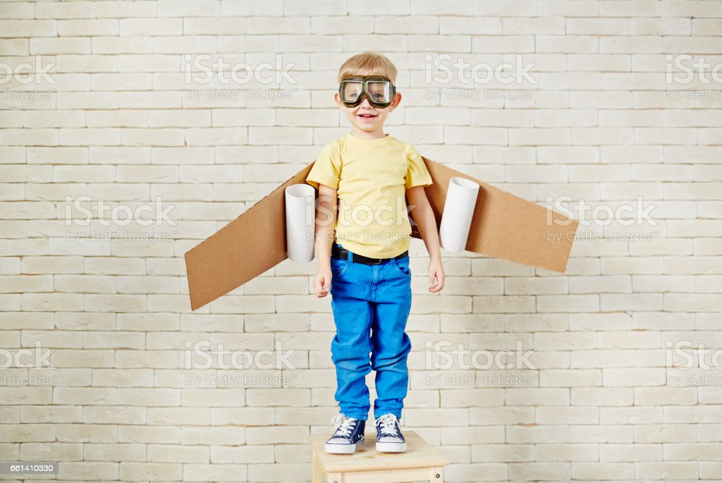 Portrait of little boy playing in pilot stock photo