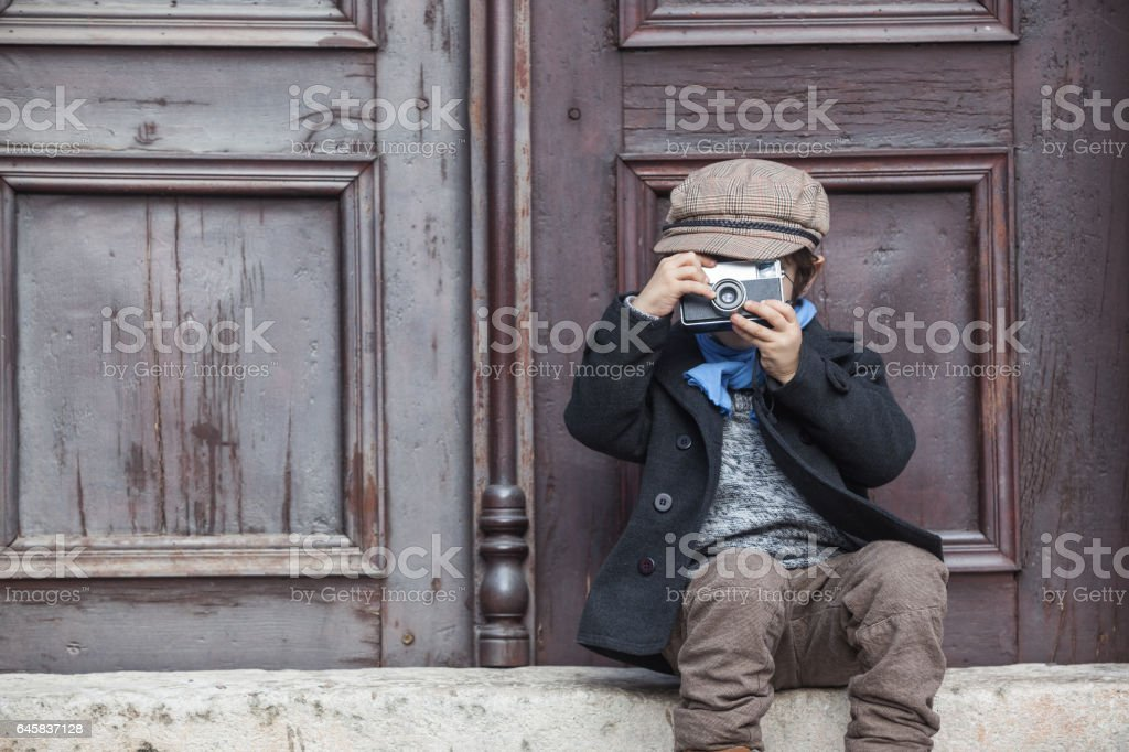 Portrait Of Little Boy Posing With His Camera stock photo