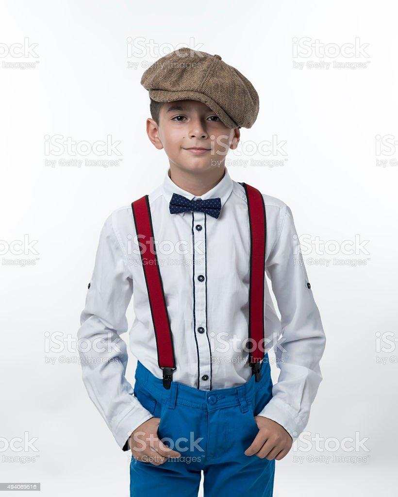 Portrait of little boy wearing a flat newsboy cap stock photo