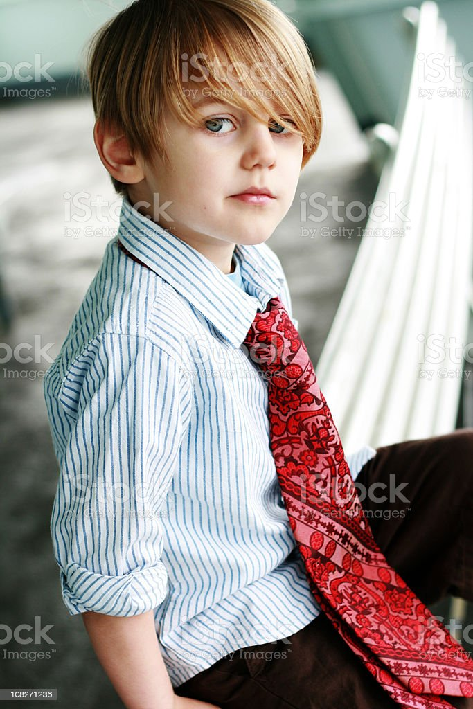 Portrait of Little Boy Wearing Dress Shirt and Neck Tie royalty-free stock photo