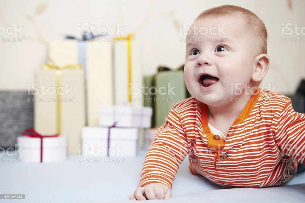 Portrait of little boy with gifts. First birthday. royalty-free stock photo