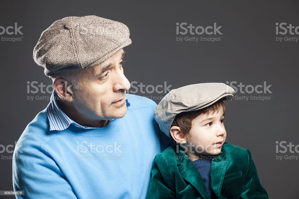 Portrait Of Little Boy With Grandfather stock photo