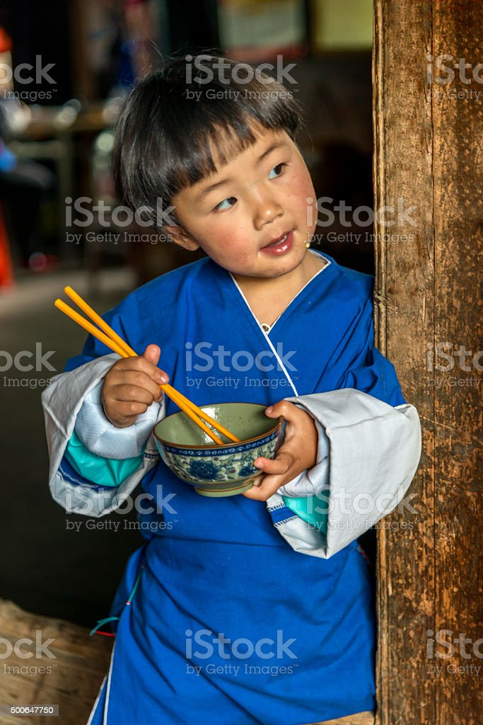 Portrait of little girl eating dinner stock photo