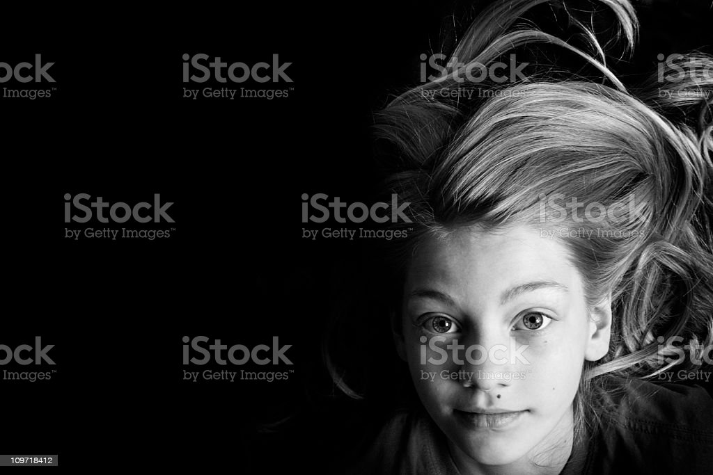 Portrait of Little Girl Lying on Back, Black and White royalty-free stock photo