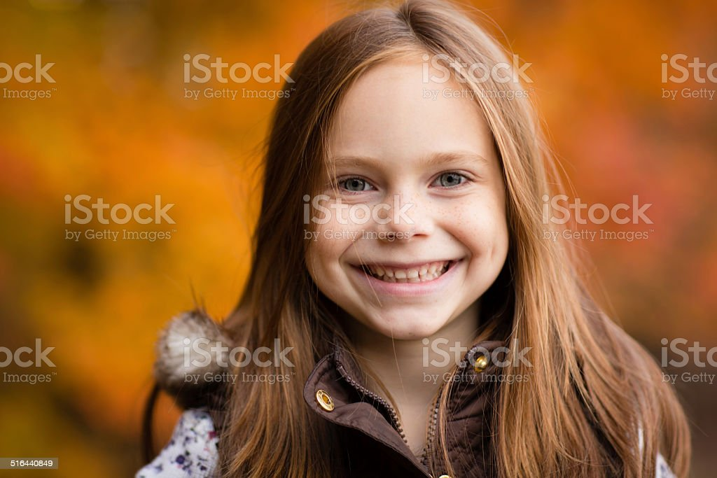 Portrait of Little Girl Outside on Fall Day stock photo