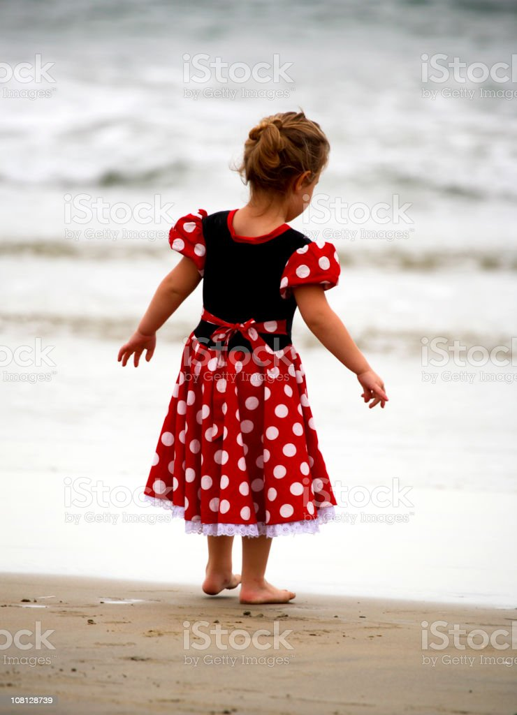 Portrait of Little Girl Standing on Beach royalty-free stock photo