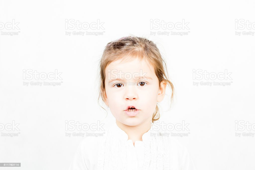 Portrait of little girl talking with mouth open stock photo