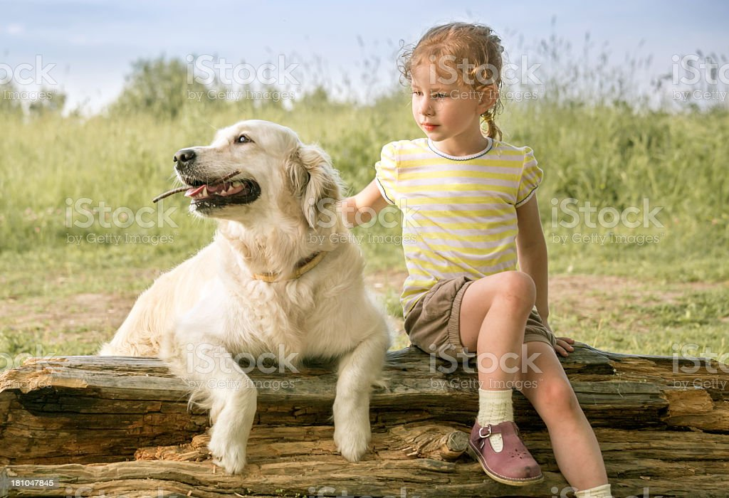 Portrait of little girl with dog outdoor royalty-free stock photo