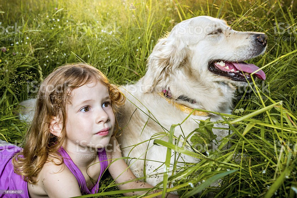 Portrait of little girl with dog outdoors royalty-free stock photo