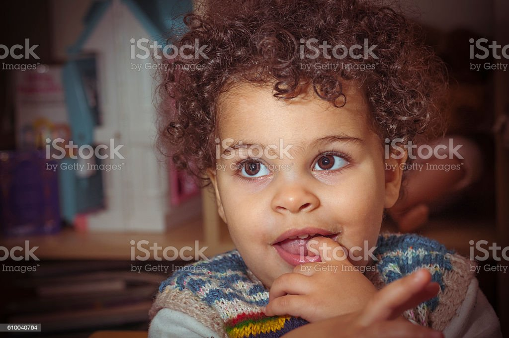 Portrait of (2-3) Little Girl With Her Finger in Mouth stock photo