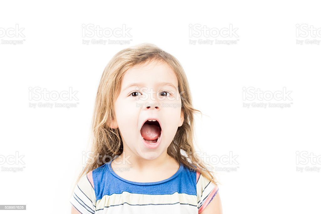 Portrait of little girl with mouth open stock photo