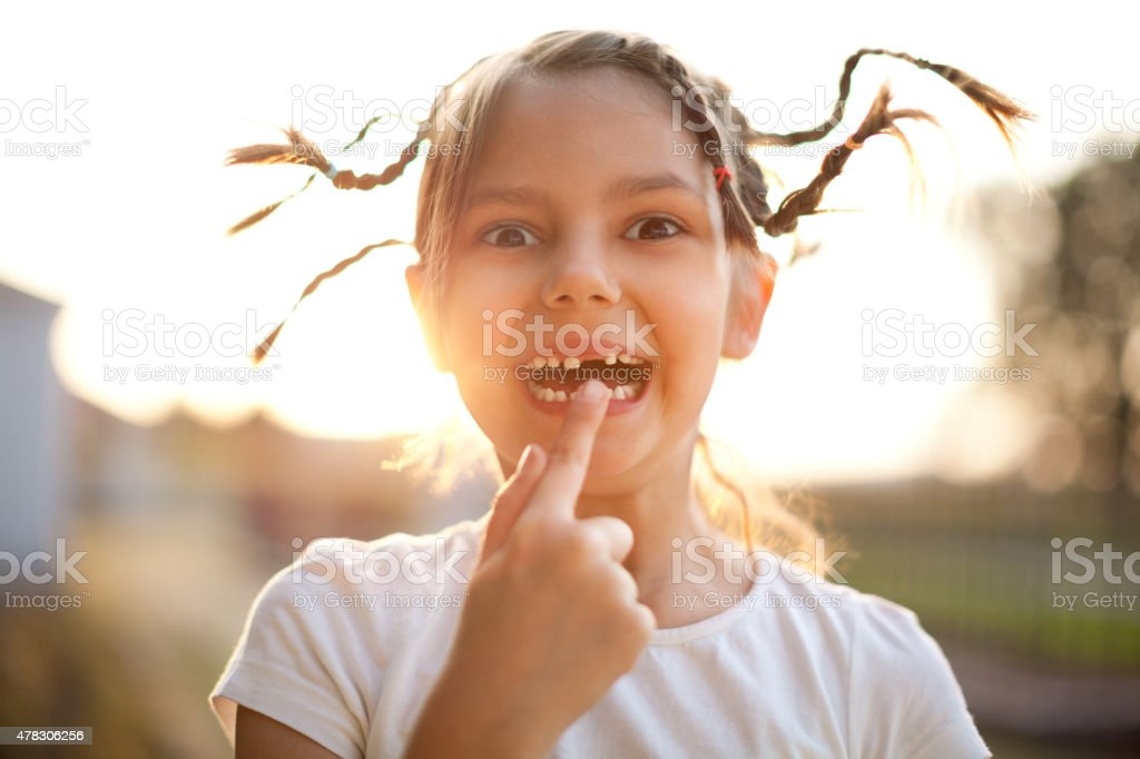 Portrait of little girl with pigtails taken outdoors stock photo