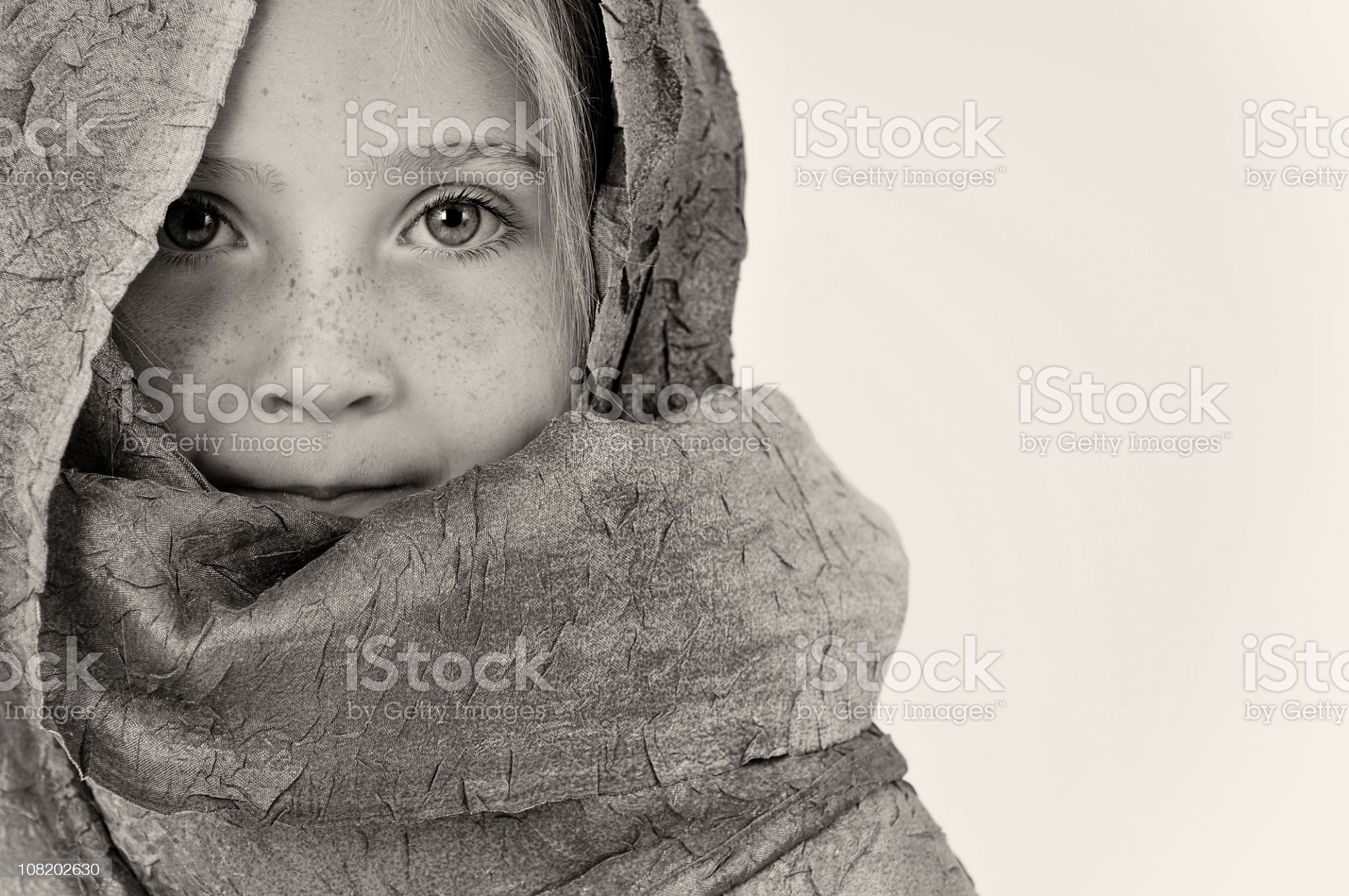 Portrait of Little Girl Wrapped in Shawl, Black and White royalty-free stock photo
