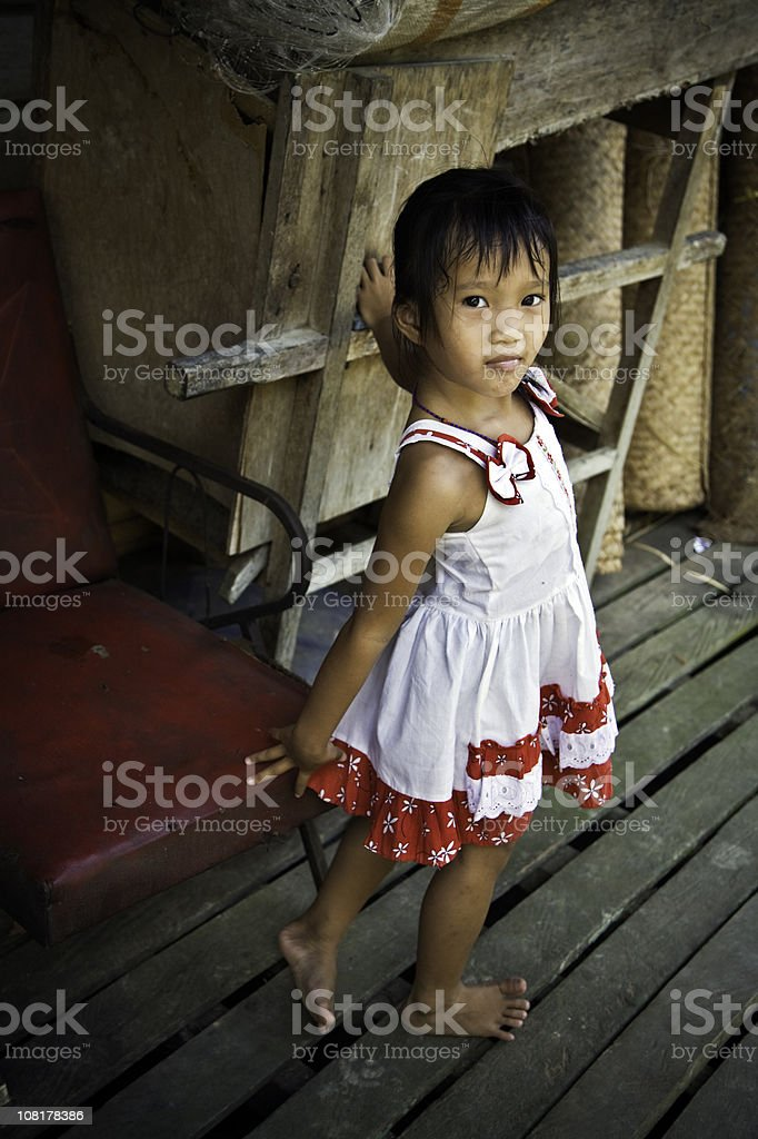 Portrait of Little Malaysian Girl Standing on Deck stock photo